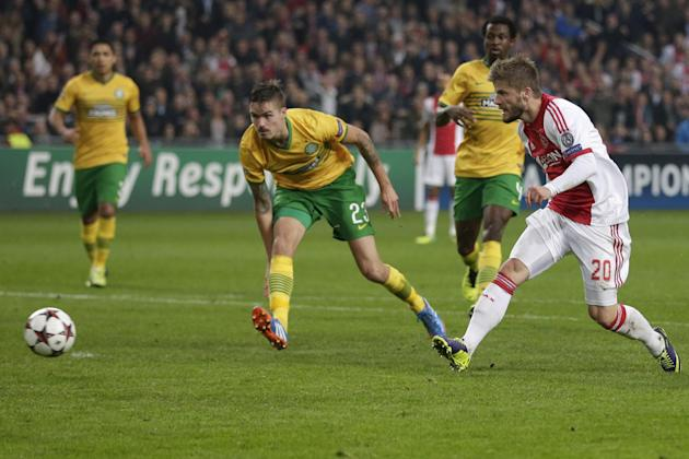 Ajax's Lasse Schone, right, scores 1-0 before Celtic's Mikael Lustig, center, can intercept during the Champions League Group H soccer match between Ajax Amsterdam and Celtic Glasgow at ArenA stadium