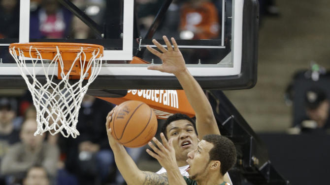 Miami's Trey McKinney Jones (4) shoots over Wake Forest's Devin Thomas (2) during the first half of an NCAA college basketball game in Winston-Salem, N.C., Saturday, Feb. 23, 2013. (AP Photo/Chuck Burton)