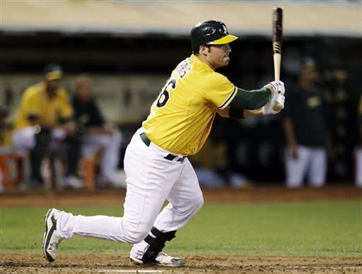 A's forge 1st-place tie with 3-1 win over Rangers
