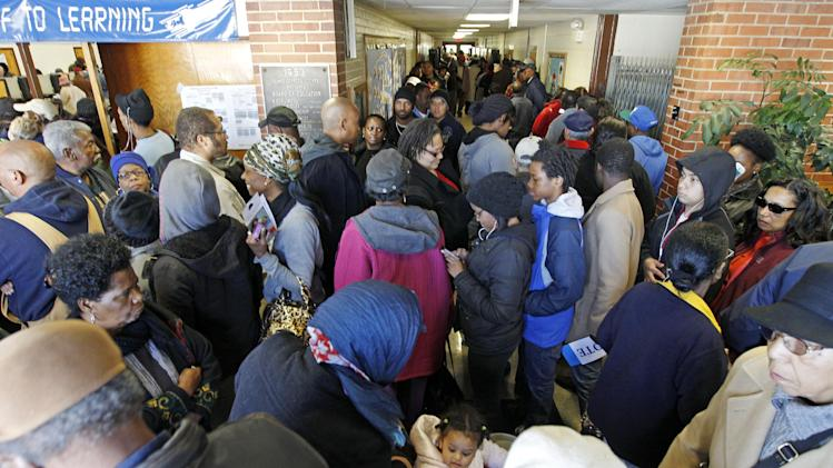 A crowd waits in line to cast their votes in the general election at Ridgecrest Elementary, in Hyattsville, Md. on Tuesday, Nov. 6, 2012.  (AP Photo/Jose Luis Magana)