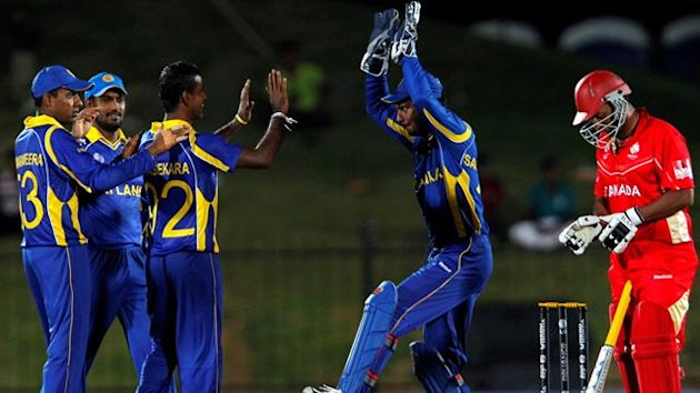 ri Lanka's captain Kumar Sangakkara (2nd R) congratulates his teammate Nuwan Kulasekara (C) after he took the wicket of Canada's Khurram Chohan (R) during their ICC Cricket World Cup group A match in Hambantota, south of Colombo, February 20, 2011