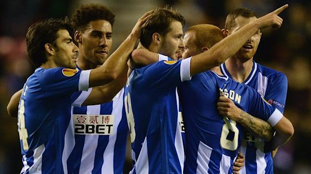Wigan Athletic's Nick Powell (3rd R) celebrates scoring with teamates against FC Rubin Kazan during their Europa League soccer match at the DW Stadium in Wigan, northern England, October 24, 2013. REUTERS