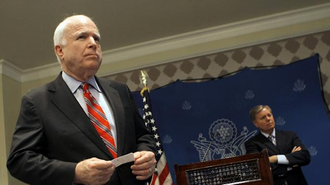 """FILE - In this Aug. 6, 2013 file photo, Sen. John McCain, R-Ariz., left, and by Sen. Lindsey Graham, R-S.C. listen during a news conference in Cairo, Egypt. The US is sending confused message about Egypt. McCain gets OK from White House to go to Egypt, then goes and holds news conference spouting views contrary to administration. Local media in Egypt reporting that McCain and el-Sissi had confrontations over the issues. Meanwhile deputy Secretary of State Bill Burns is in Egypt, forbidden to talk to Morsi, while meeting with minor Brotherhood officials and the military. This after Kerry said the military was """"restoring democracy"""" by ousting democratically elected president. (AP Photo/Amr Nabil, File)"""