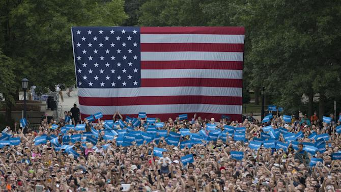 The crowd cheers as President Barack Obama speaks at a campaign event at University of Iowa, Friday, Sept. 7, 2012, in Iowa City, Iowa.  (AP Photo/Carolyn Kaster)