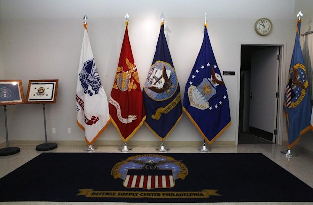In this Tuesday, June 12, 2012 photo, hand embroidered flags stand at the Defense Logistics Agency in Philadelphia. About 10 miles from the house where Betsy Ross is believed to have sewn the first U.