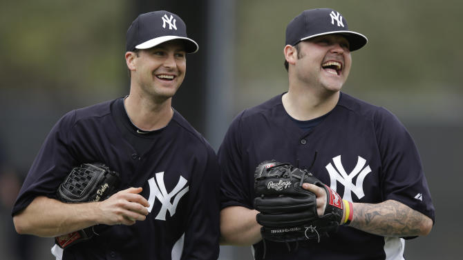 New York Yankees' Joba Chamberlain, right, laughs with non-roster invitee Matt Daley during a workout at baseball spring training, Wednesday, Feb. 13, 2013, in Tampa, Fla. (AP Photo/Matt Slocum)