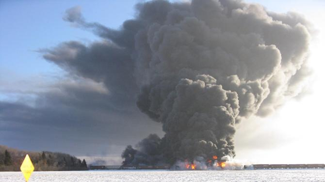 This photo submitted to The Associated Press by Cass County Commissioner Ken Pawluk shows a train derailment and fire west of Casselton, N.D., Monday, Dec. 30, 2013. (AP Photo/Ken Pawluk)