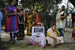 Indian women listen to a speaker during a protest on …