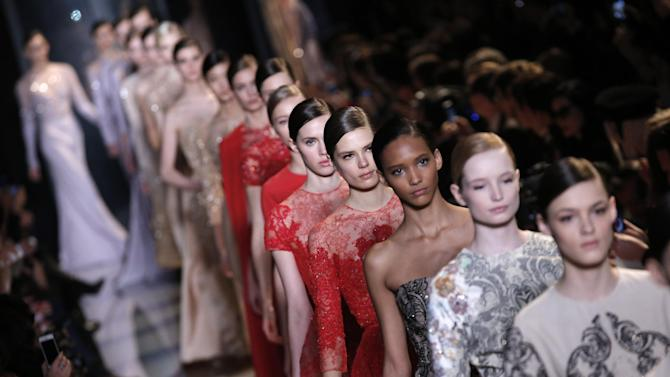 Models present creations by Lebanese fashion designer Elie Saab for his Spring Summer 2013 Haute Couture fashion collection, presented in Paris, Wednesday, Jan.23, 2013. (AP Photo/Christophe Ena)