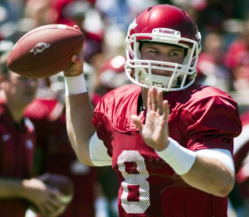 Arkansas quarterback Tyler Wilson warms up before a spring NCAA college football game in Fayetteville, Ark., Saturday, April 21, 2012. (AP Photo/April L. Brown)