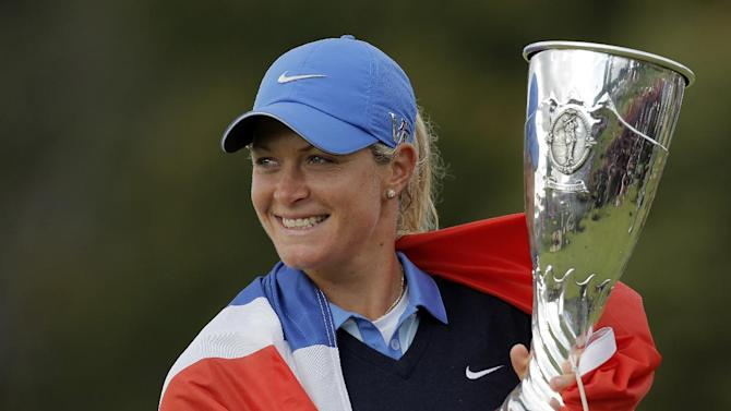 Suzann Pettersen of Norway looks on as she holds her trophy after winning the Evian Championship women's golf tournament in Evian, eastern France, Sunday, Sept. 15, 2013. (AP Photo/Laurent Cipriani)