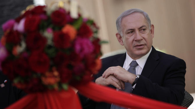 Israeli Prime Minister Benjamin Netanyahu attends a ceremony at the Shanghai Jewish Refugees Museum in Shanghai, China, Tuesday, May 7, 2013. China is hosting both the Palestinian and Israeli leaders this week in a sign of its desire for a larger role in the Middle East. (AP Photo/Eugene Hoshiko)