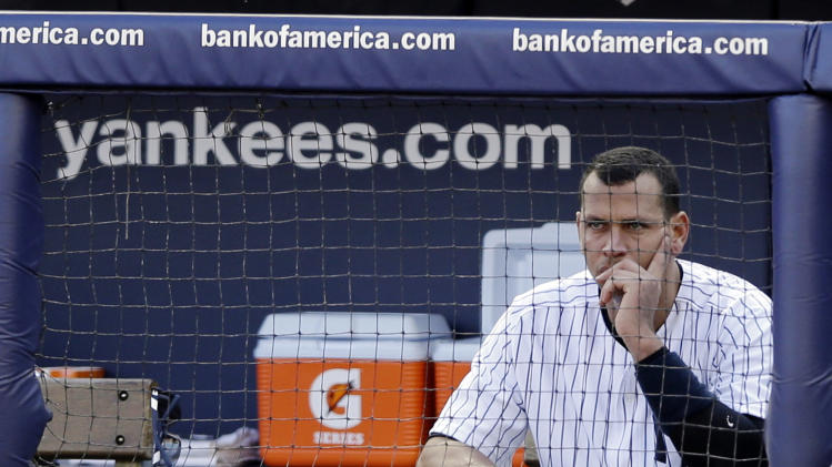 New York Yankees' Alex Rodriguez sits in the dugout after striking out in the second inning of Game 2 of the American League championship series against the Detroit Tigers on Sunday, Oct. 14, 2012, in New York. (AP Photo/Matt Slocum)