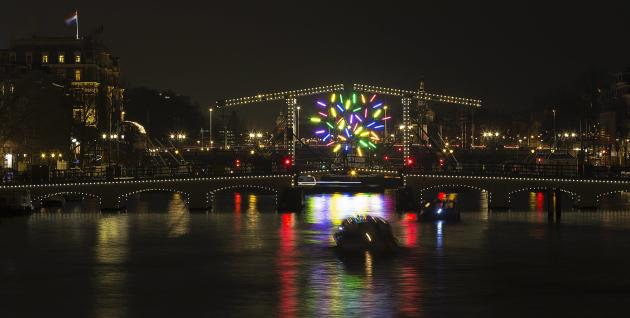 """Big Tree"" by French artist Jacques Rival is pictured on the Magere brug as part of the Amsterdam Light Festival in Amsterdam"