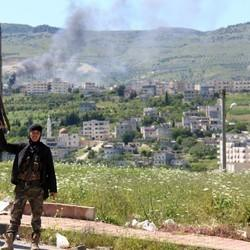 Assad's Troops Bombard Key Syrian Town After It Falls To Rebels