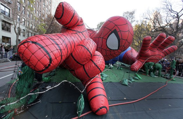 Workers inflate the Spider-Man balloon for the 86th annual Macy&#39;s Thanksgiving Day Parade, on New York&#39;s Upper West Side, Wednesday, Nov. 21, 2012. More than 3 million people typically attend the event and it has a TV audience of 50 million. (AP Photo/Richard Drew)