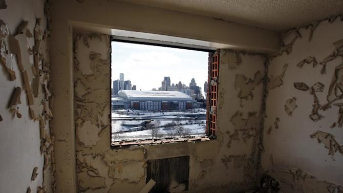 FILE - In this photo taken Feb. 18, 2010, downtown Detroit and Ford Field are seen from a window at the Brewster-Douglass Housing Projects in Detroit, where singers Diana Ross and the Supremes lived before becoming Motown singing superstars. Mayor Dave Bing has called a news conference for Thursday, Nov. 15, 2012, to announce plans for the projects, which Bing said in his March State of the City address that he wanted to demolish this year. (AP Photo/Carlos Osorio, file)