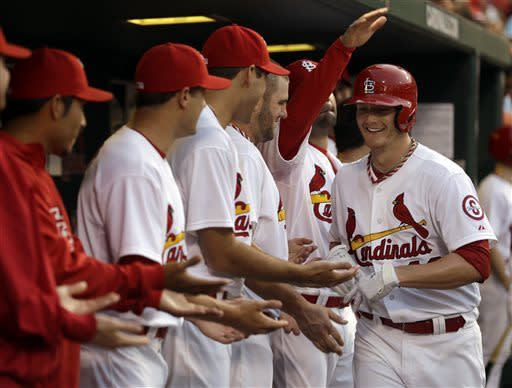 Miller homers, pitches Cards over Arizona 12-8