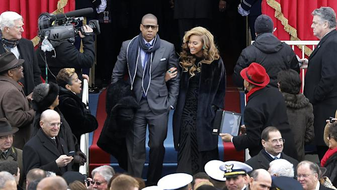 Beyonce and Jay-Z arrive at the ceremonial swearing-in for President Barack Obama at the U.S. Capitol during the 57th Presidential Inauguration in Washington, Monday, Jan. 21, 2013. (AP Photo/Scott Andrews, Pool)