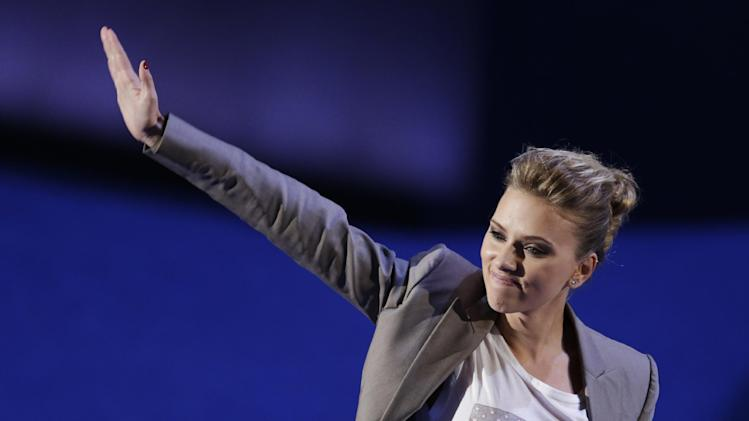 Actress Scarlett Johansson waves after speaking to delegates at the Democratic National Convention in Charlotte, N.C., on Thursday, Sept. 6, 2012. (AP Photo/Lynne Sladky)