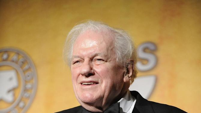 In this Sunday, Jan. 27, 2008 photo, Charles Durning holds his life achievement award at the 14th Annual Screen Actors Guild Awards in Los Angeles. Durning, the two-time Oscar nominee who was dubbed the king of the character actors for his skill in playing everything from a Nazi colonel to the pope, died Monday, Dec. 24, 2012 at his home in New York City. He was 89. (AP Photo/Chris Pizzello)