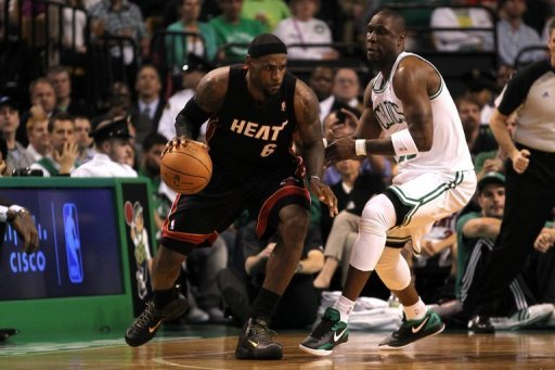 NBA Most Valuable Player LeBron James (L) had 34 points, eight rebounds and five assists for Miami