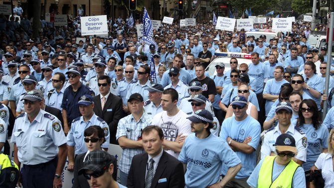 New South Wales police officers  stage a protest rally outside the states parliament house in Sydney, Australia, Tuesday, Nov. 22, 2011. More than 3000 officers took part in the rally, calling for a change in the proposed government death and disability policy saying it would cut payments to injured officers. (AP Photo/Rob Griffith)