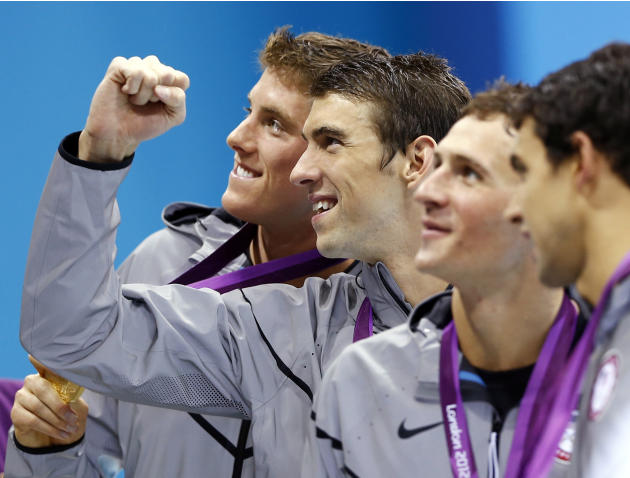FILE - In this July 31, 2012, file photo, from left, Conor Dwyer, Michael Phelps, Ryan Lochte and Ricky Berens, all of the United States, pose with their gold medals after their win in the men's 4x200