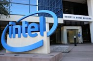 Intel Corp. stunned the tech sector Friday by sharply cutting its revenue outlook for the current quarter, citing weak demand for personal computers and slower growth from emerging economies