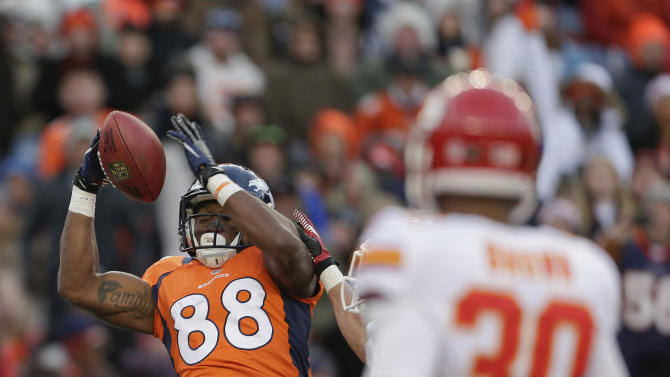 Denver Broncos wide receiver Demaryius Thomas (88) pulls down a high pass for a touchdown against the Kansas City Chiefs in the third quarter of an NFL football game, Sunday, Dec. 30, 2012, in Denver. (AP Photo/Joe Mahoney)
