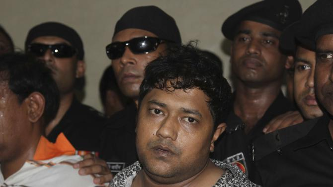 Mohammed Sohel Rana, the fugitive owner of an illegally-constructed building that collapsed last week in Bangladesh, is produced before the media in Dhaka, Bangladesh, Sunday, April 28, 2013. Rana was arrested near the land border in Benapole in western Bangladesh, just as he was about to flee into India's West Bengal state, said Jahangir Kabir Nanak, junior minister for local government,. (AP Photo/Palash Khan)
