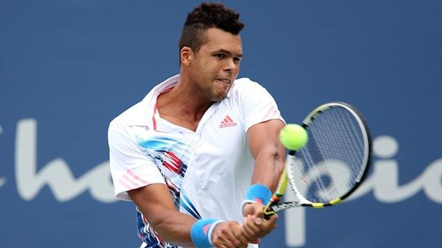 Jo-Wilfried Tsonga returns a shot to Sergiy Stakhovsky during the third round of the Winston-Salem Open at Wake Forest University (AFP)