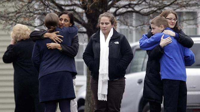 Mourners gather outside the funeral service of Sandy Hook Elementary School shooting victim, Jack Pinto, 6, Monday, Dec. 17, 2012, in Newtown, Conn. A gunman walked into Sandy Hook Elementary School in Newtown Friday and opened fire, killing 26 people, including 20 children. (AP Photo/David Goldman)