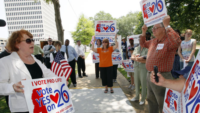 """** File ** In this June 6, 2011 file photo, Dr. Beverly McMillan, president of Pro-Life Mississippi, left, thanks supporters at a prayer rally in Jackson, Miss., for their support on efforts to get a proposed """"personhood"""" constitutional amendment offered to voters. The amendment offers a  definition of a person not now found in the Mississippi Constitution. (AP Photo/Rogelio V. Solis, File)"""
