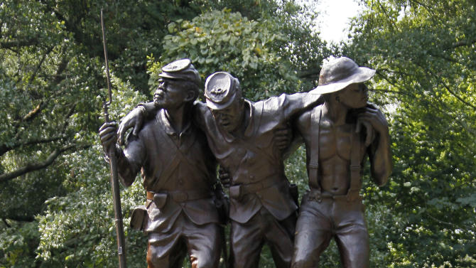 This nine-foot tall sculpture photographed at the Vicksburg National Military Park in Vicksburg, Miss., Thursday, Aug. 16, 2012, honors black soldiers and civilians that fought for their freedom and in support of the Union. The statue depicts three figures - two Union soldiers representing the 1st and 3d Mississippi Infantry, African Descent, and participated in the Vicksburg campaign, and the third figure is a civilian laborer, right. (AP Photo/Rogelio V. Solis)