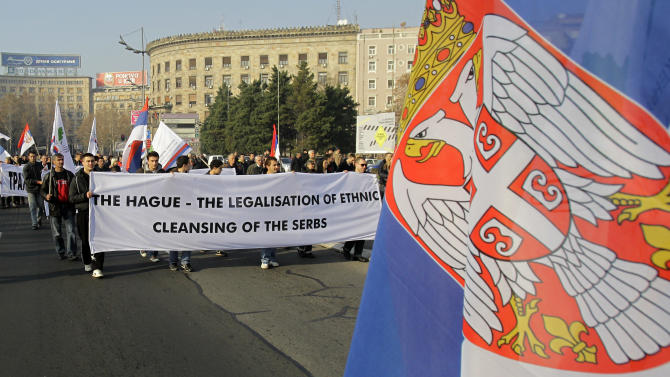 Protesters carrying a banner during protest march against the Hague war crimes tribunal, in Belgrade, Serbia, Sunday, Nov. 25, 2012. Serbia is furious that the appeals judges at the war crimes court at the Hague  last Friday freed Croat  generals Ante Gotovina and Mladen Markac, who previously had been sentenced to lengthy prison terms for crimes against Serbs. (AP Photo/Darko Vojinovic)