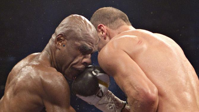 Glen Johnson, left, of Jamaica, battles Lucian Bute, of Romania, during their IBF super middleweight championship boxing bout in Quebec City on Saturday, Nov. 5, 2011. Bute defended his IBF super-middleweight title with a one-sided unanimous decision. (AP Photo/The Canadian Press, Jacques Boissinot)