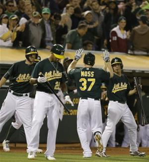 Moss has 2 HRs, Straily pitches A's past Yanks 5-2