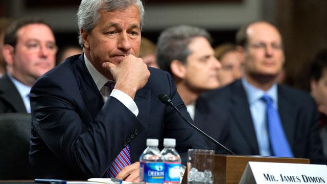 JP Morgan CEO's Pay Cut After Loss