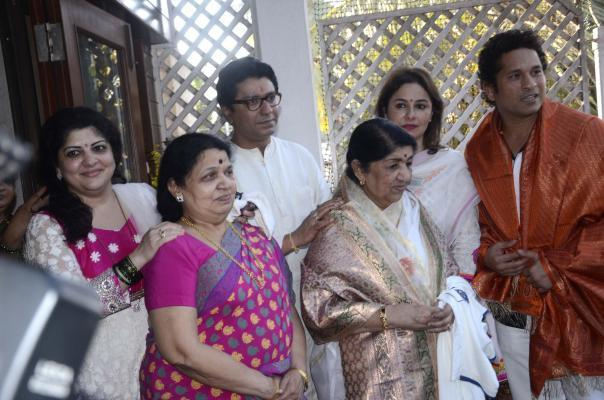Veteran singer Lata Mangeshkar, cricket legend Sachin Tendulkar, Anjali Tendulkar and MNS Chief Raj Thackeray at Thackeray's residence in Mumbai on March 9, 2014. (Photo: Sandeep Mahankal/IANS)