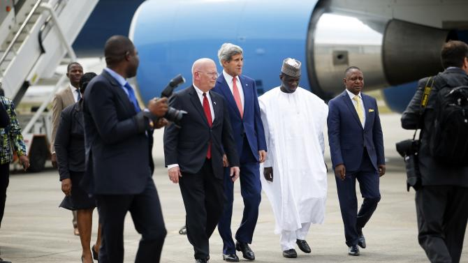 U.S. Ambassador to Nigeria Entwistle and Secretary of State Kerry walk with Nigerian government officials upon Kerry's arrival in Lagos