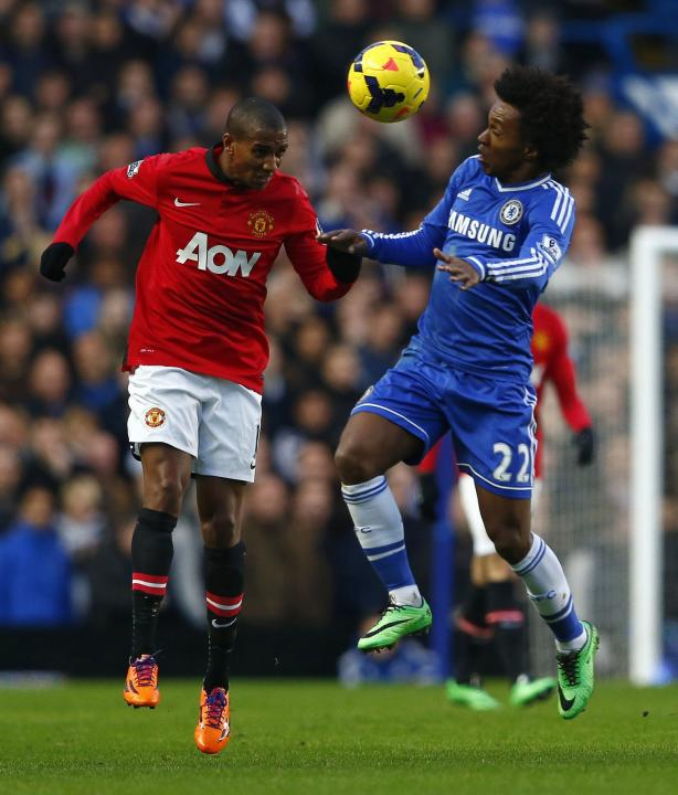 Chelsea's Willian challenges Manchester United's Young during their English Premier League soccer match at Stamford Bridge