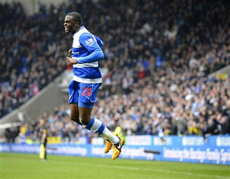 Reading's Hope Akpan celebrates scoring against Aston Villa during their English Premier League soccer match at The Madejski Stadium, Reading, southern England