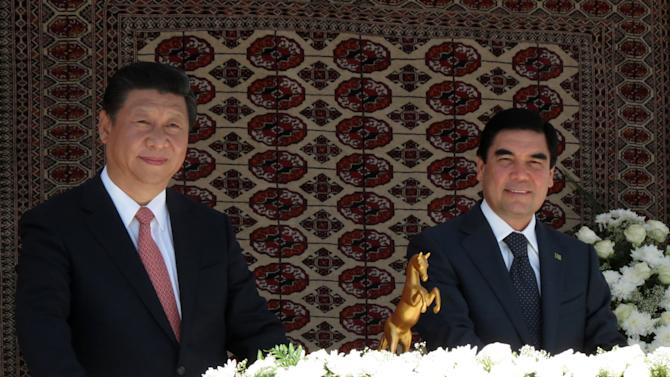 Chinese President Xi Jinping and Turkmen President Gurbanguli Berdymukhamedov, right, attend a ceremony marking the start of gas production at the South Yolotan field in Turkmenistan, Wednesday, Sept. 4, 2013. Turkmenistan has begun pumping natural gas from a vast field near the Afghan border that will help it more than double exports to China in coming years. (AP photo)