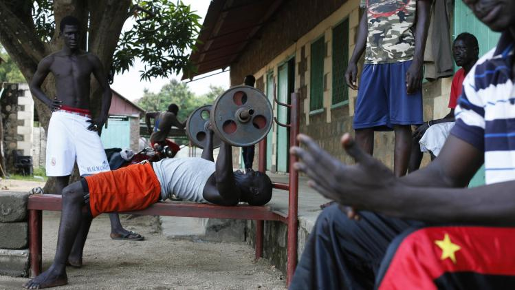 A bodybuilder lifts weights at a sports centre in Juba