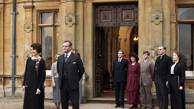 """This undated publicity photo provided by PBS shows, from left, Elizabeth McGovern as Lady Grantham, Hugh Bonneville as Lord Grantham, Dan Stevens as Matthew Crawley, Penelope Wilton as Isobel Crawley, Allen Leech as Tom Branson, Jim Carter as Mr. Carson, and Phyllis Logan as Mrs. Hughes, from the TV series, """"Downton Abbey.""""  The third season premiere airs in the U.S. on Sunday, Jan. 6, 2013 on PBS. (AP Photo/PBS, Carnival Film & Television Limited 2012 for MASTERPIECE, Nick Briggs)"""