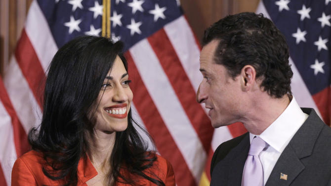 Rep. Anthony Weiner, D-N.Y., and his wife, Huma Abedin, an aide to Secretary of State Hillary Rodham Clinton, are pictured after a ceremonial swearing in of the 112th Congress on Capitol Hill in Washington in this photo taken Jan. 5, 2011. (AP Photo/Charles Dharapak)