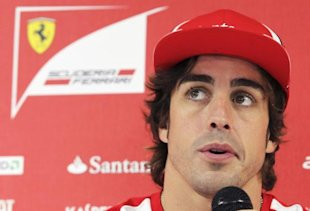 Ferrari Formula One driver Alonso of Spain addresses a news conference ahead of the weekend's Belgian F1 Grand Prix in Spa Francorchamps