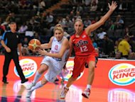 Diana Taurasi of the USA (R) women's Olympic team vies with Jo Leedham of Great Britain women's Olympic team during their Olympic warm up game at the Manchester Arena in Manchester, north-west England on July 18. US Women's NBA stars seek a fifth consecutive Olympic gold medal and bring a 33-game Olympic win streak into Saturday's start of matches