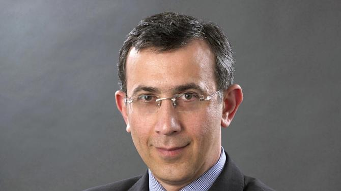 This undated publicity image released by Al Jazeera America shows Ehab Al Shihabi. Al Shihabi, executive director for international operations, has been named as an interim chief executive officer of Al Jazeera America. (AP Photo/Al Jazeera America)